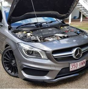 silver Mercedes with bonnet up